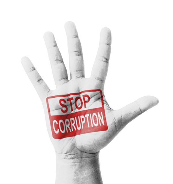 Open hand raised, Stop Corruption sign painted