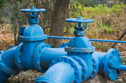Detail photograph of large blue water pipes.